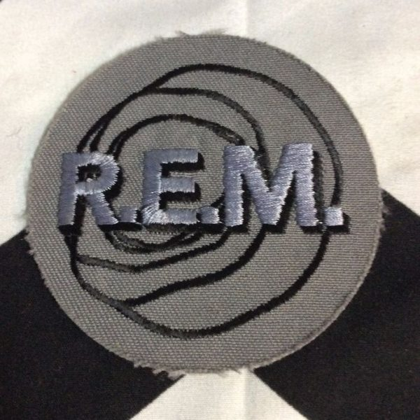 product details: EMBROIDERED PATCH - REM LOGO - CIRCLE SHAPE photo