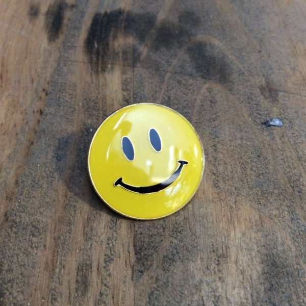 product details: CLASSIC SMILEY FACE ENAMEL PIN photo