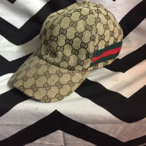Gucci Dad hat with monogram GG pattern and stripe ribbon on side 1