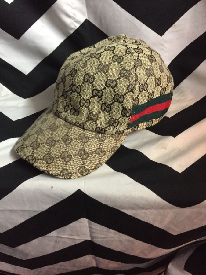 Gucci Dad hat with monogram GG pattern and stripe ribbon on side 1 c63a77e0b2c