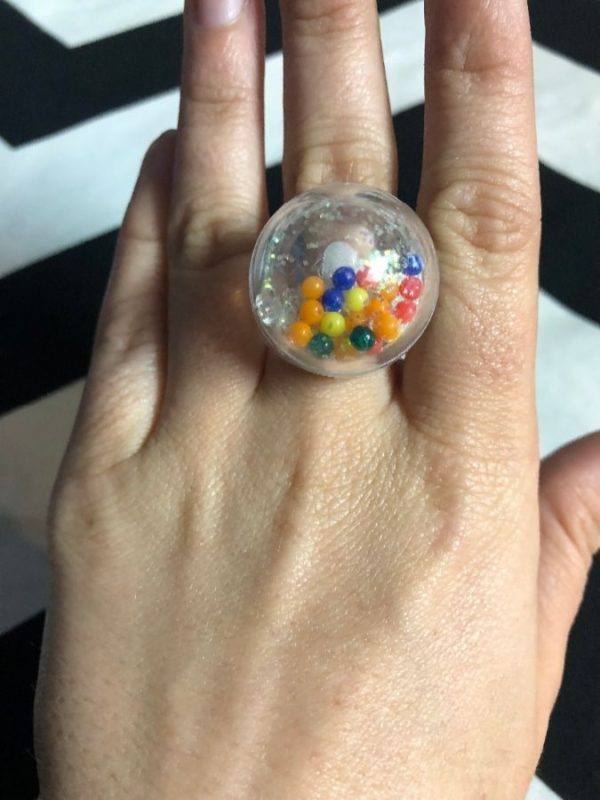 product details: RING PLASTIC BUBBLE W/ RAINBOW BALLS & GLITTER photo