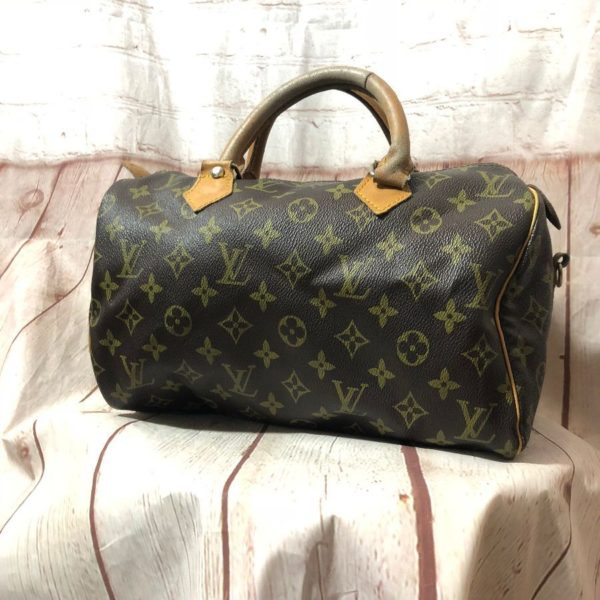 product details: LOUIS VUITTON SMALL SPEEDY LEATHER ZIP PULL-TAB photo