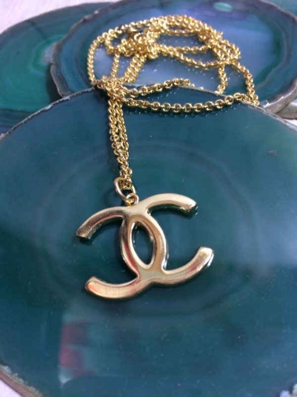 product details: GOLD METAL CHANEL LOGO NECKLACE W/ SMALL LINK CHAIN photo