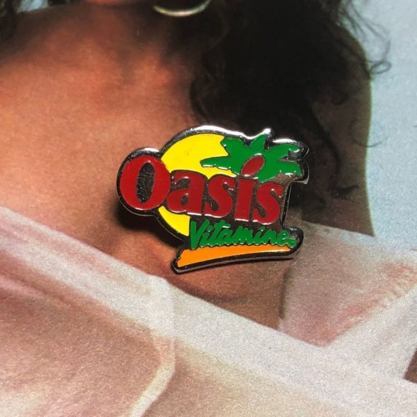 product details: VINTAGE OASIS VITAMINES LOGO ENAMEL PIN photo