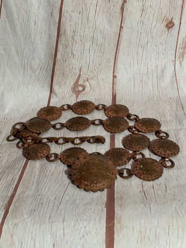 product details: COPPER METAL CONCHOS W/ FLORAL DESIGN & CHAIN BELT photo