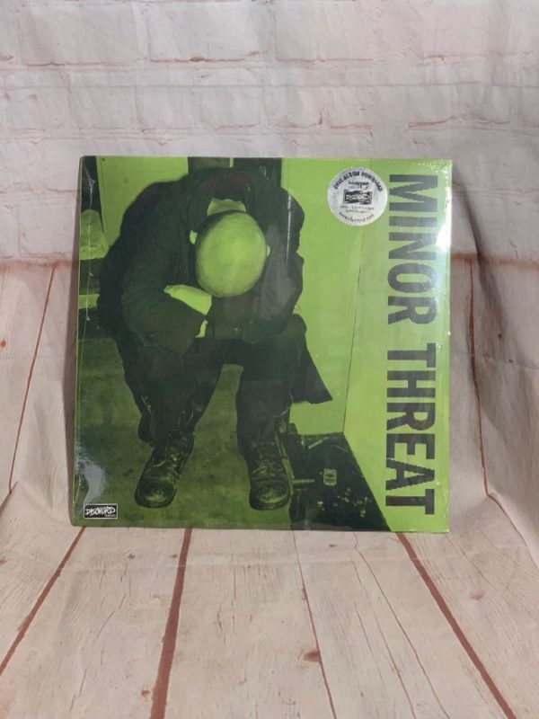 product details: VINYL RECORD - MINOR THREAT - FIRST TWO 7'S photo