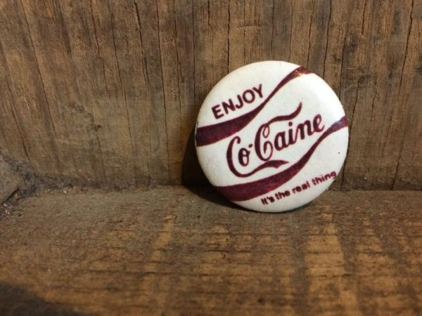 ROUND ENJOY CO-CAINE BUTTON