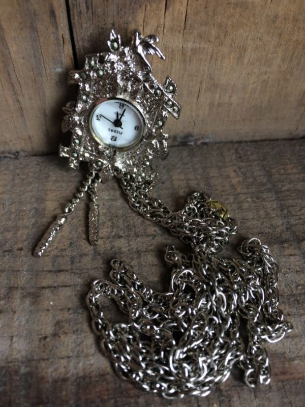 product details: WATCH/NECKLACE - CUCKOO CLOCK DESIGN photo