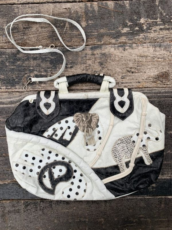 product details: 1980S OVERSIZED WHITE GENUINE LEATHER PATCHWORK PURSE WITH LARGE METAL ELEPHANT MOTIF photo