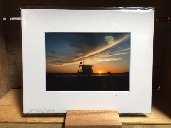 product details: THE SURFER WALKING BESIDE THE SUNSET MOUNTED PHOTOGRAPH photo