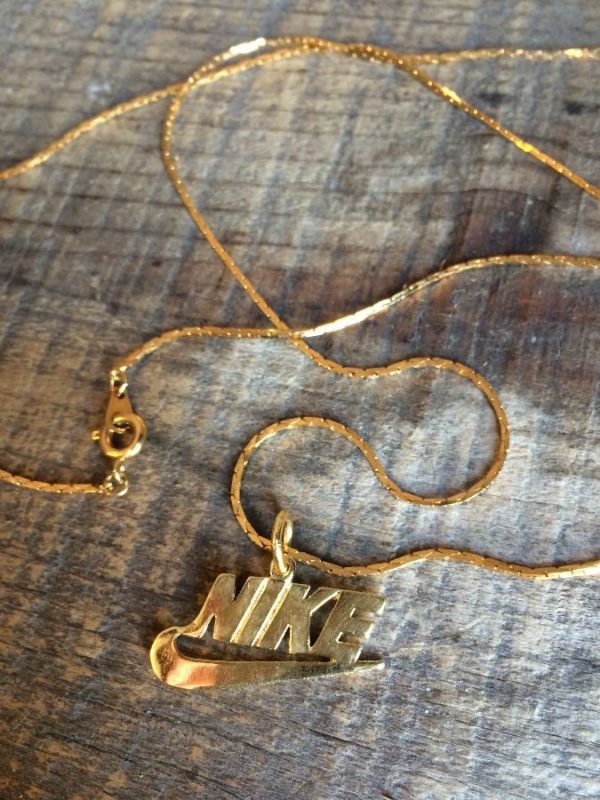 product details: NIKE EMBLEM SOLID BRASS CHARM NECKLACE W/ GOLD PLATED MINI COBRA SNAKE CHAIN NECKLACE photo