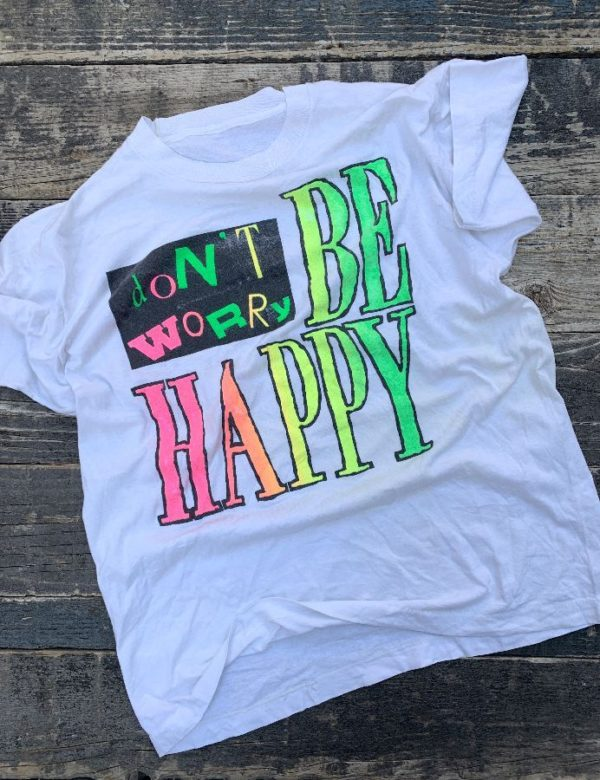 product details: DONT WORRY BE HAPPY DISTRESSED NEON PUFF INK GRAPHIC T-SHIRT photo