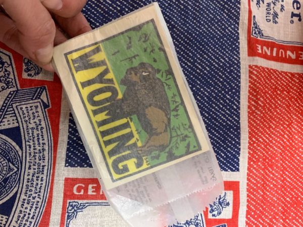 product details: VINTAGE WYOMING DECAL STICKER IN ORIGINAL WAX PAPER PACKAGE photo