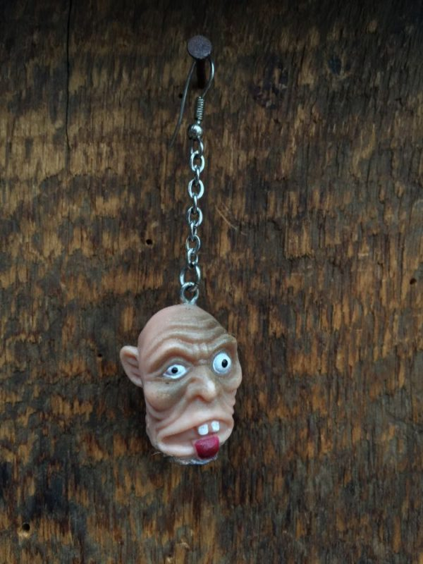 product details: SEVERED BALD HEAD ON CHAIN EARRING - SINGLE photo