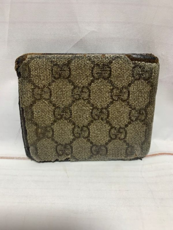product details: DISTRESSED GUCCI MONOGRAM LEATHER WALLET photo