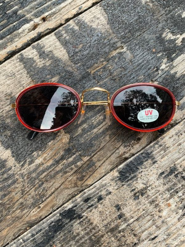 product details: DEADSTOCK 1990S RED RIMMED OVAL LENS GOLD FRAME SUNGLASSES WITH UV PROTECTION AS-IS photo