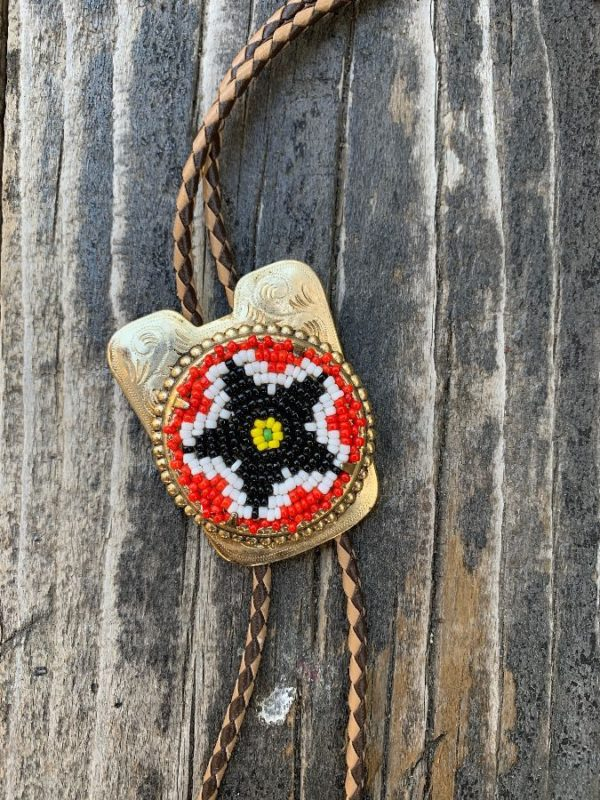 product details: FUN FUNKY 1980S BOLO TIE BEADED STAR SLIDE TWO TONE BRAIDED LEATHER CORD AND ARROWHEAD TIPS photo