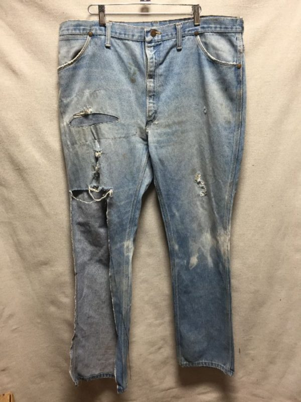 product details: VINTAGE GRUNGY COMPLETELY THRASHED AND DISTRESSED BAGGY WRANGLER JEANS FUL FRONT PANEL MISSING photo