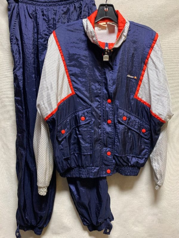 product details: VERY COOL 1980S 2 PIECE NYLON TRACK SUIT GRID PATTERN CONTRAST BUTTONS photo