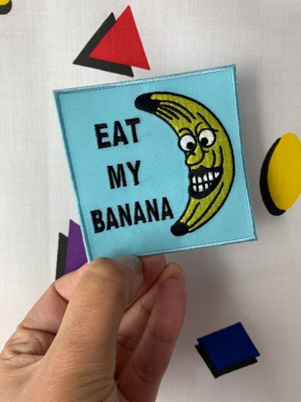 product details: FUNNY EAT MY BANANA EMBROIDERED IRON-ON OR SEW-ON SQUARE PATCH photo