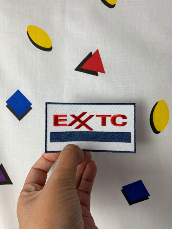 product details: EXXTC EXXON LOGO PARODY EMBROIDERED RECTANGULAR PATCH photo