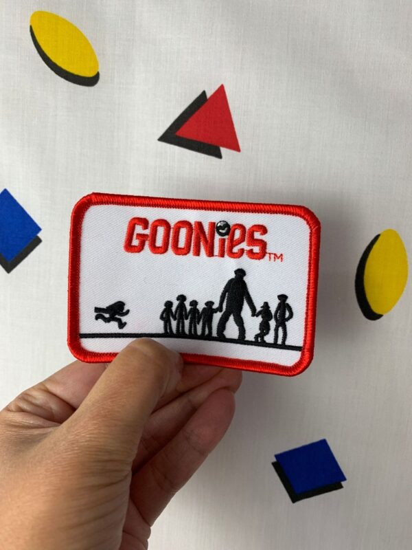 product details: GOONIES EMBROIDERED IRON-ON OR SEW-ON PATCH RED BORDER photo