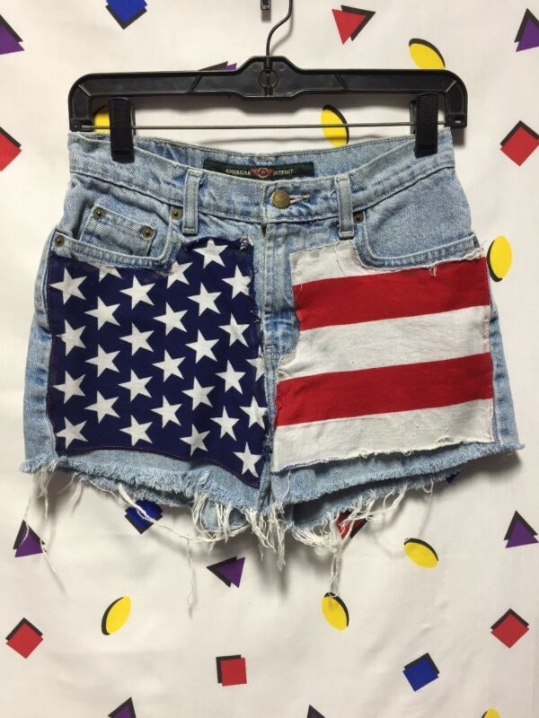 product details: RECONSTRUCTED LIGHT WASH DENIM SHORTS WITH AMERICAN FLAG PATCH AS-IS photo