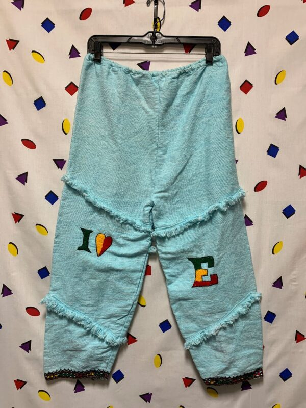 product details: I HEART ETHIOPIA COTTON CROPPED PANTS FRAYED PATCHWORK EMBROIDERED BOTTOM photo