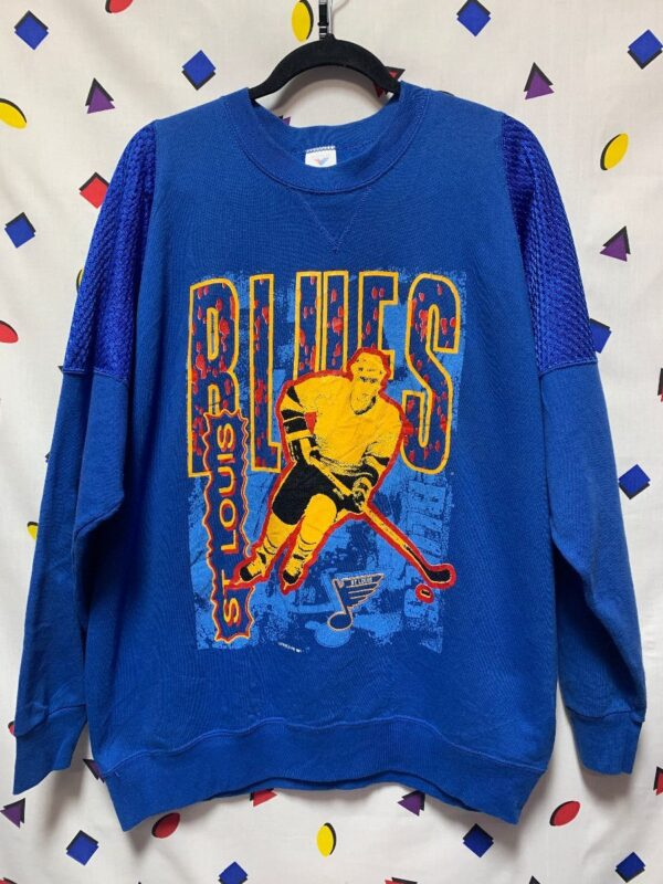 product details: ST. LOUIS BLUES SWEATSHIRT WITH HOCKEY PLAYER GRAPHIC AND MESH SHOULDER DETAIL photo