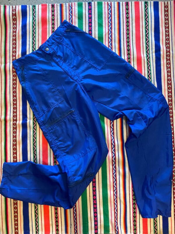 product details: DEADSTOCK HIGH-WAISTED NYLON PARACHUTE PANTS ZIPPER POCKETS AND FRONT ZIP ANKLES photo