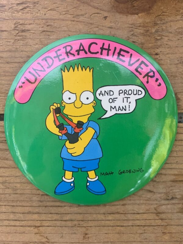 product details: BART SIMPSON OVERSIZED BUTTON UNDERACHIEVER AND PROUD OF IT MAN photo