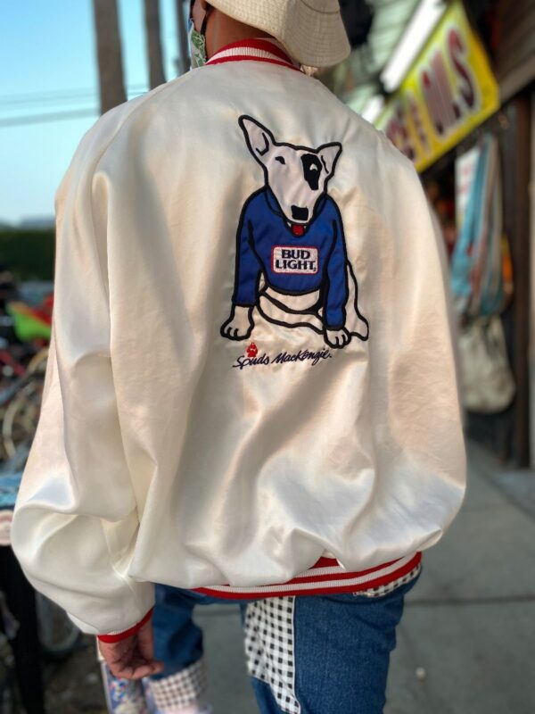 product details: 1987 SPUDS MACKENZIE SATIN BOMBER JACKET WITH EMBROIDERED BUD LIGHT PATCH AND SPUDS BACK PATCH STRIPED COLLAR AND CUFFS AS-IS photo