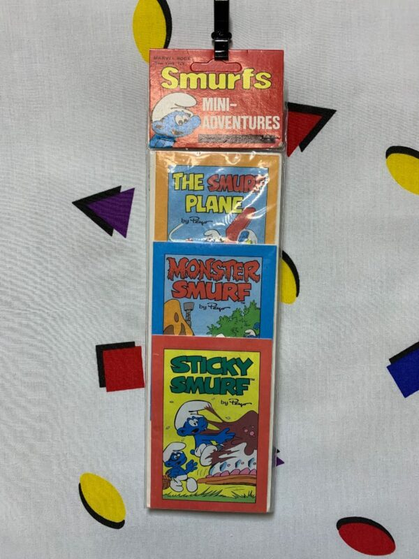 product details: DEADSTOCK MINI COMIC BOOKS SET OF 3 PER PACK THE SMURF PLANE MONSTER SMURF STICKY SMURF photo