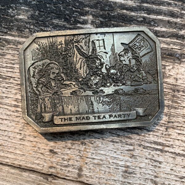 product details: VINTAGE ALICE IN WONDERLAND THE MAD TEA PARTY 1974 SOLID BRASS BELT BUCKLE photo