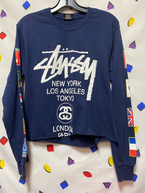 product details: STUSSY INTERNATIONAL LS CROPPED TEE WITH SLEEVE  CITY LOGOS AS-IS photo