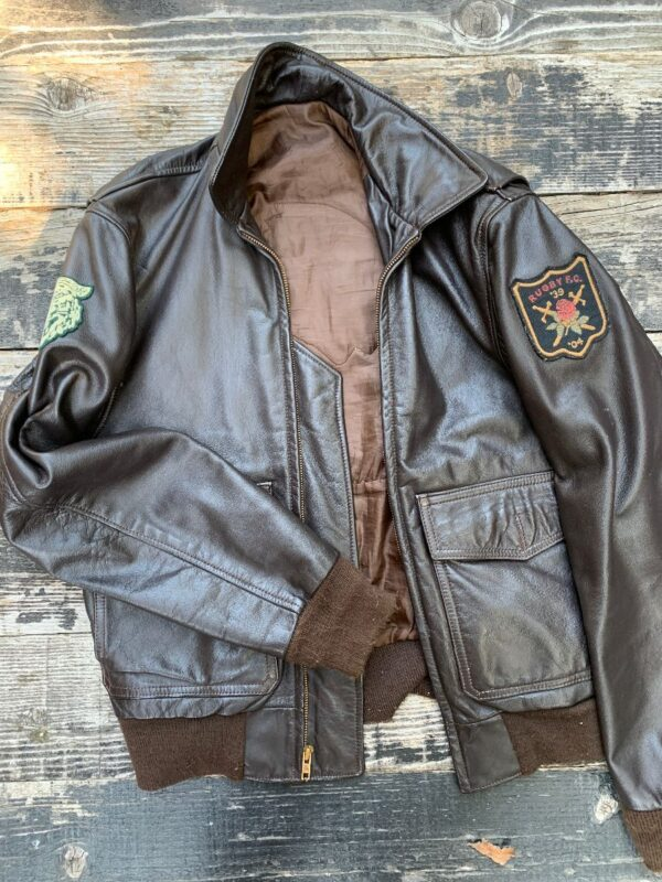 product details: LEATHER JACKET WITH ARM PATCHES AND NATIVE AMERICAN BACK PATCH AS-IS photo