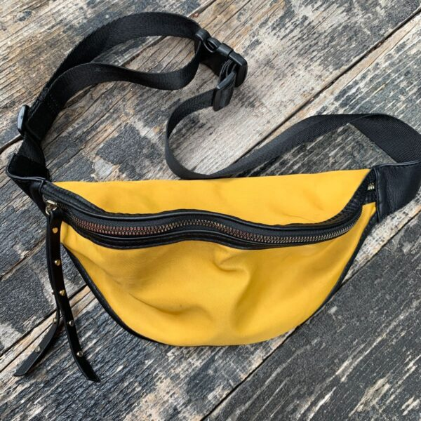 product details: SUPER CUTE NYLON YELLOW EXTERIOR POLKA DOT INTERIOR TWO POCKET STUDDED PULL FANNY PACK photo
