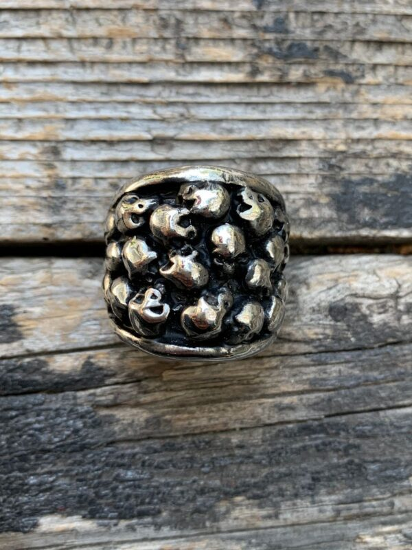 product details: WALL OF SKULLS AZTEC TZOMPANTLI RING CHUNKY STAINLESS STEEL BIKER RING photo