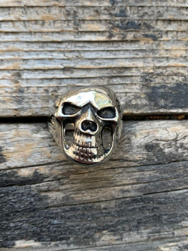 product details: CREEPY SMILING SKULL CHUNKY STAINLESS STEEL BIKER RING photo