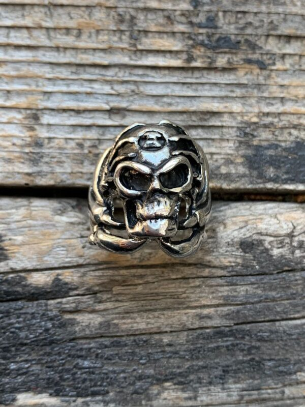 product details: DEATH SKULL WITH SKELETON HANDS OVER HEAD CHUNKY STAINLESS STEEL BIKER RING photo