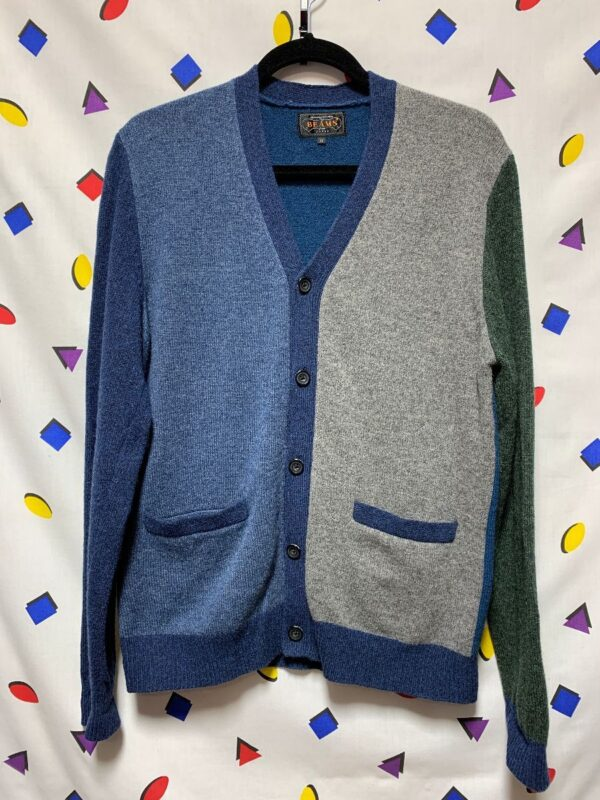 product details: CLASSIC WOOL V NECK FIVE BUTTON COLOR BLOCK CARDIGAN SWEATER DUAL HIP POCKET FITTED JERSEY CUFFS AND WAISTLINE photo