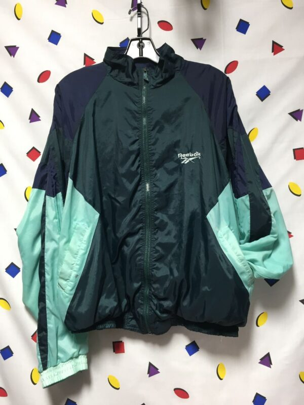 product details: RAD TWO TONE REEBOK LOGO ZIP UP JACKET COLOR BLOCK WITH POCKETS AND COTTON LINING photo