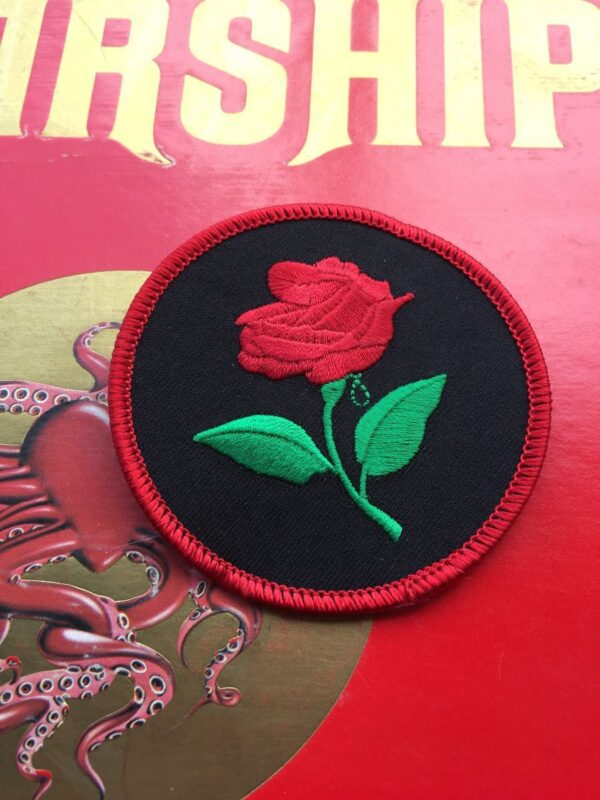 product details: EMBROIDERED ROSE BLACK RED CIRCULAR PATCH photo