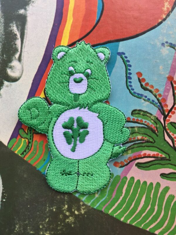 product details: CARE BEARS GOOD LUCK BEAR 4 LEAF CLOVER LUCKY EMBROIDERED PATCH photo