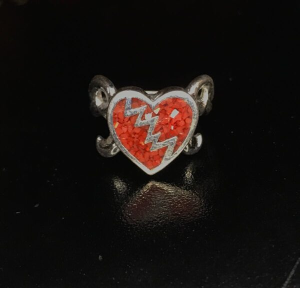 product details: LOVE STINKS BROKEN HEART CRUSHED CORAL RED SILVER RING photo
