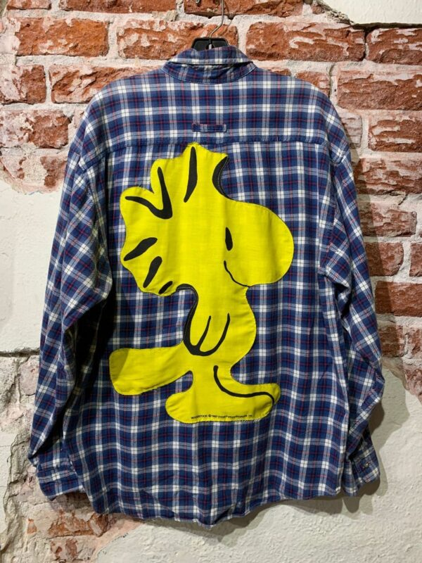 product details: LONG SLEEVE BUTTON DOWN FLANNEL 1965 PEANUTS WOODSTOCK BACK PATCH photo