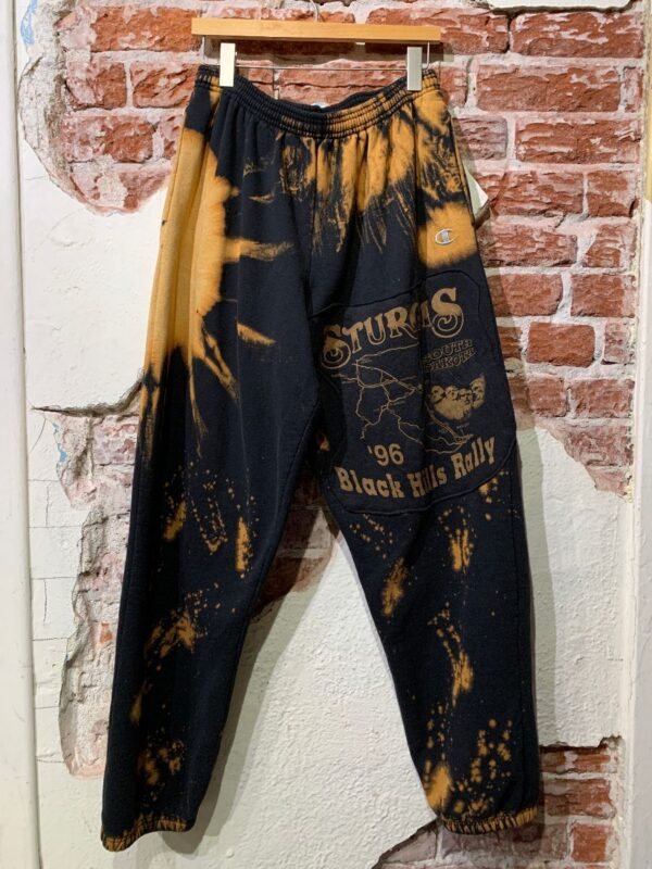 product details: REPURPOSED MINERAL WASH AND SPLATTER SWEATPANTS W/ STURGIS PATCH photo