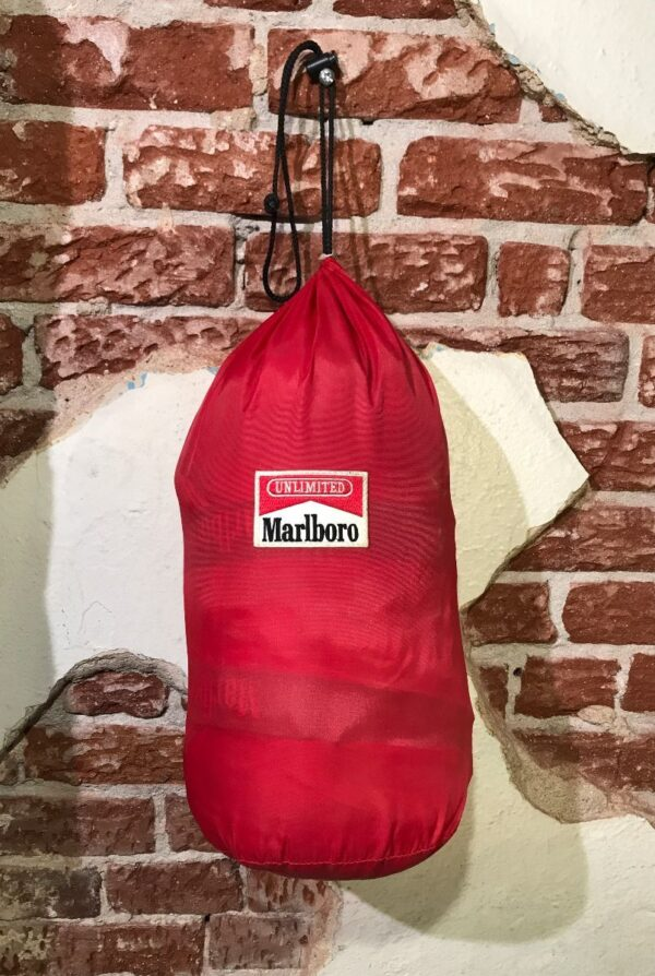 product details: VINTAGE MARLBORO UNLIMITED GEAR SLEEPING BAG WITH RED ROLL UP DRAWSTRING BAG photo