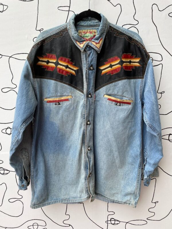 product details: AS-IS LONG SLEEVE BUTTON DOWN WESTERN DENIM SHIRT WITH NATIVE DESIGN LEATHER APPLIQUÉ photo