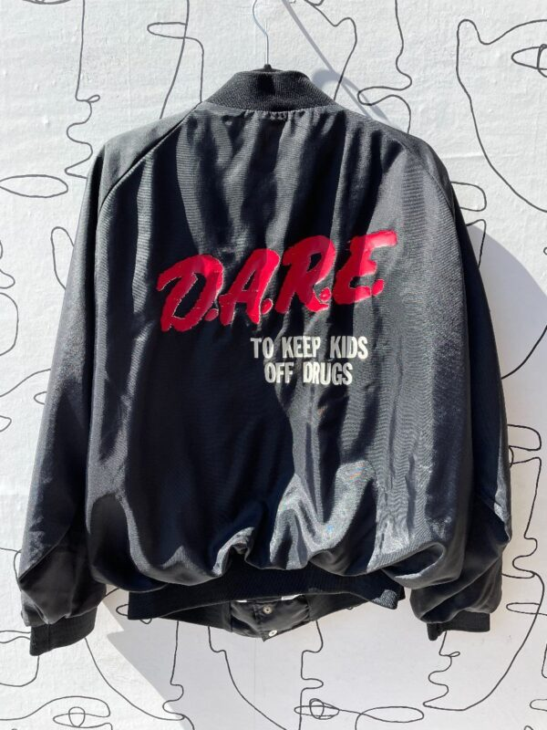 product details: AS IS DARE TO KEEP KIDS OFF DRUGS BOMBER JACKET photo